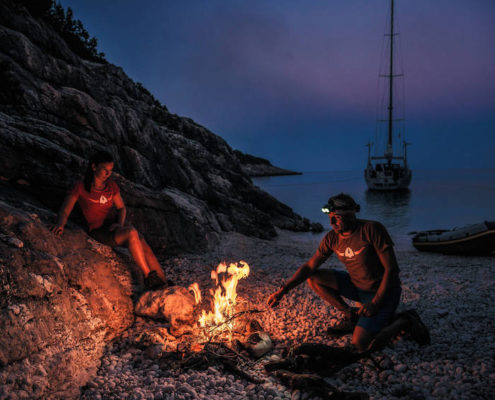 Daniela Bärnthaler and Christian Schiester runnung and sailing at the Ionian Sea in Greece on July 2016 Beach Fire